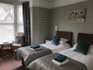 A bed or beds in a room at Wordsworths Guest House