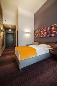 Кровать или кровати в номере Hotel Tobaco Łódź