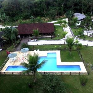 A view of the pool at Pousada Praia de Itamambuca or nearby