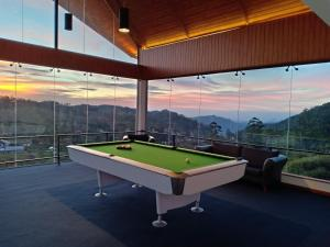 A pool table at Hilldale Retreat