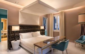 Un ou plusieurs lits dans un hébergement de l'établissement Sina Centurion Palace