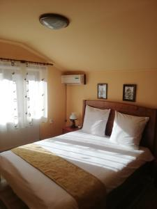 A bed or beds in a room at Casa Soare