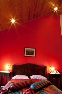 Ένα ή περισσότερα κρεβάτια σε δωμάτιο στο Ξενοδοχείο Κύναιθα