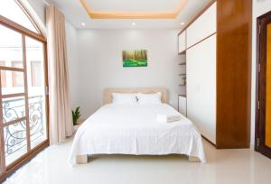A bed or beds in a room at CBD Home - Home in Central - The Art