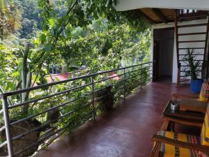 A balcony or terrace at Vago Hostel - Home