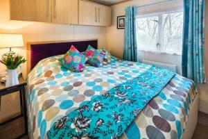 A bed or beds in a room at Holiday Home Beauport