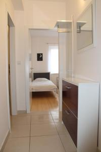 A bed or beds in a room at Apartman M&M