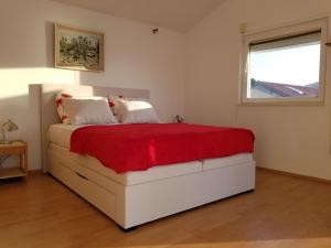 A bed or beds in a room at Villa Malo Misto
