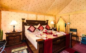 A bed or beds in a room at Fun Retreat Resort, Hotel and Ayurveda Spa