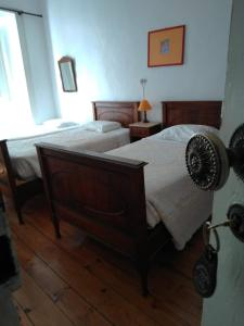 A bed or beds in a room at Residencial Uniao - Guest House