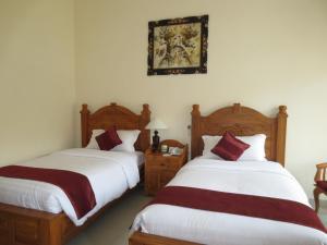 Een bed of bedden in een kamer bij Swastika Bungalows