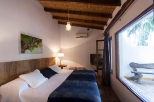 A bed or beds in a room at El Porvenir Casa de Bodega