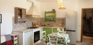A kitchen or kitchenette at Casa Confort