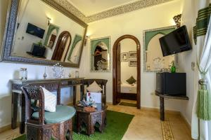A television and/or entertainment center at Riad Anabel