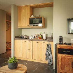 Een keuken of kitchenette bij Logement 't Voorhuysch