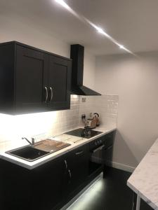 A kitchen or kitchenette at Shores Holiday Apartments