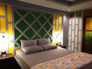 A bed or beds in a room at Baan Baimai Boutique Room