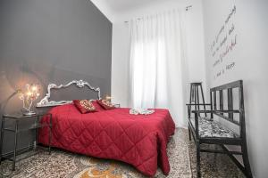 A bed or beds in a room at Homes in Genoa - Les Maisons de Genes