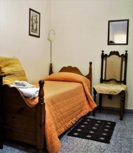 A bed or beds in a room at Il Tuo Letto Sullo Stretto