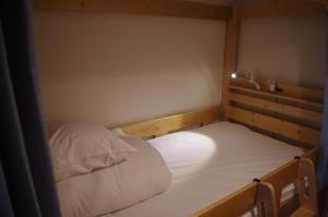 Guesthouse POPTONEにあるベッド