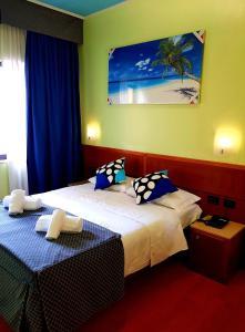ホテル ドゥカーレにあるベッド