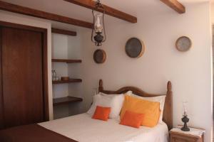 Uma cama ou camas num quarto em Retiro Da Avo Lídia - Turismo Rural