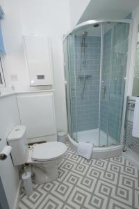 A bathroom at Air Host and Clean - Apartment 1, 13 Broadhurst Street