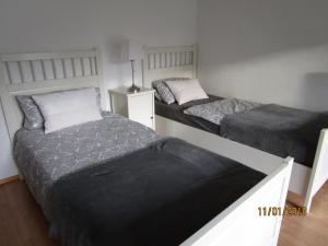 Ein Bett oder Betten in einem Zimmer der Unterkunft Studio Apartment Sonnenbühl