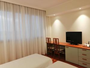 A television and/or entertainment center at Best Western Air Hotel Linate