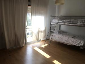 A bunk bed or bunk beds in a room at Casa Maranha