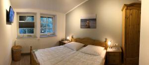 Ein Bett oder Betten in einem Zimmer der Unterkunft Haus Hugo