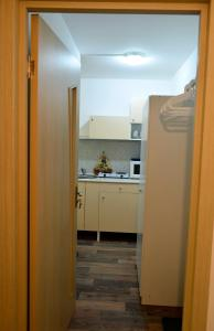 A kitchen or kitchenette at Cosy Apartment in Kryukovo