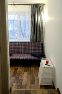 A seating area at Cosy Apartment in Kryukovo