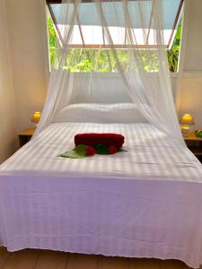 A bed or beds in a room at Manahere Lodge