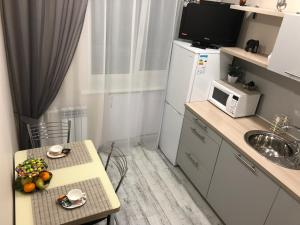 A kitchen or kitchenette at Central Tiger Apartment