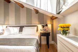 Ein Bett oder Betten in einem Zimmer der Unterkunft Hotel Grande Italia