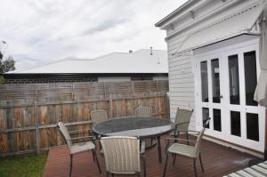 A balcony or terrace at PAPERBARK HOMESTEAD - PET FRIENDLY