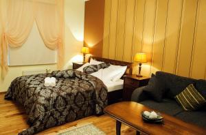 Voodi või voodid majutusasutuse Embrace Guestrooms & Apartments toas