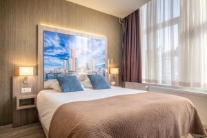 Een bed of bedden in een kamer bij Hotel Milano