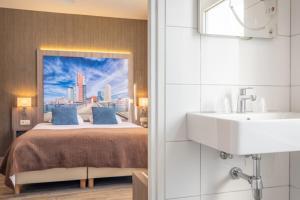 Een badkamer bij Hotel Milano