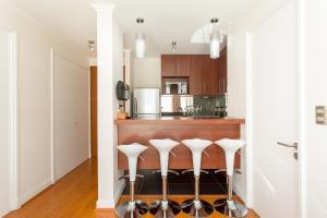 A cozinha ou cozinha compacta de City Inn Apart Home 2