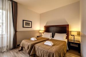 Uma cama ou camas num quarto em Hotel Boutique Nazionale