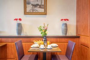 Een restaurant of ander eetgelegenheid bij Hotel Milano