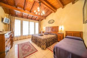 Letto o letti in una camera di Monte Tondo Winery e B&B
