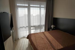 Кровать или кровати в номере Apartments Canyon-2