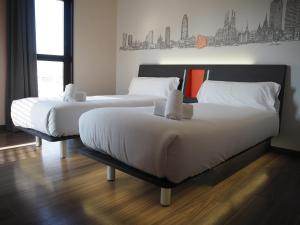 A bed or beds in a room at easyHotel Barcelona Fira