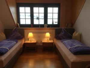 Ein Bett oder Betten in einem Zimmer der Unterkunft Apartments Luisenhöhe St Peter