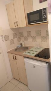 A kitchen or kitchenette at Neoresid - Résidence Saint-Exupéry