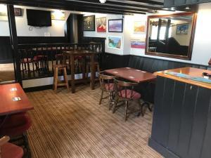 The lounge or bar area at The Swordfish Inn