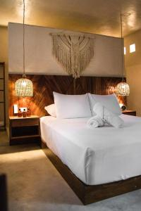 A bed or beds in a room at ALCOBAS DEL MAR